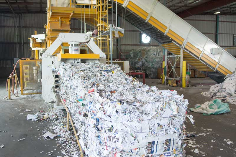 Papers being baled for recycling shredding