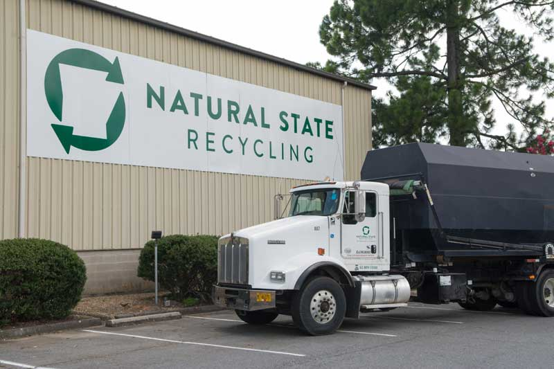 Truck with compactor box at Natural State Recycling